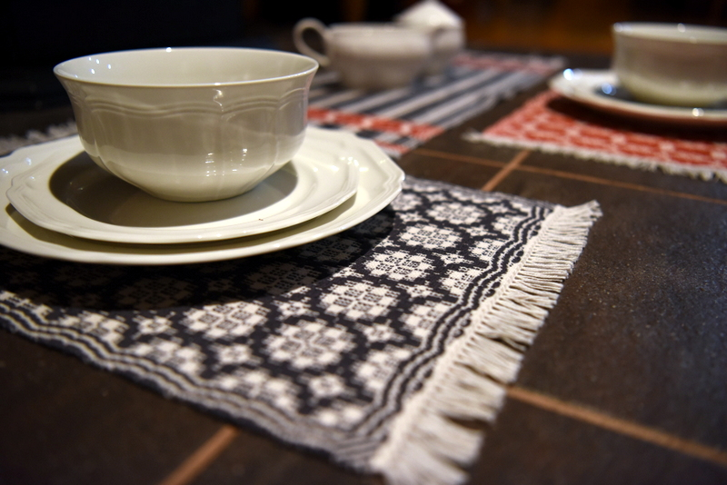 white dishes on overshot placemats